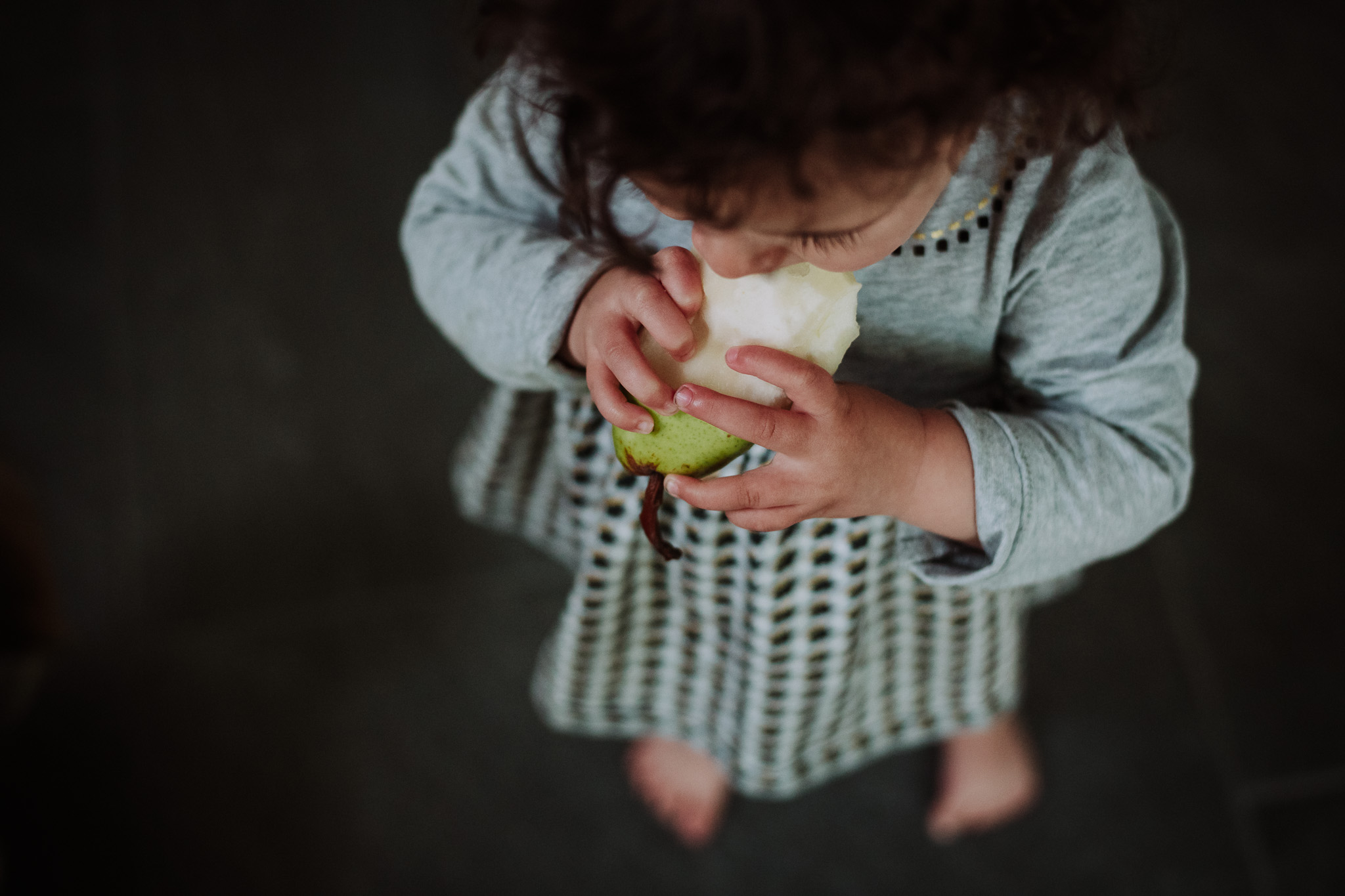 dc photographer photograph of baby eating a pear
