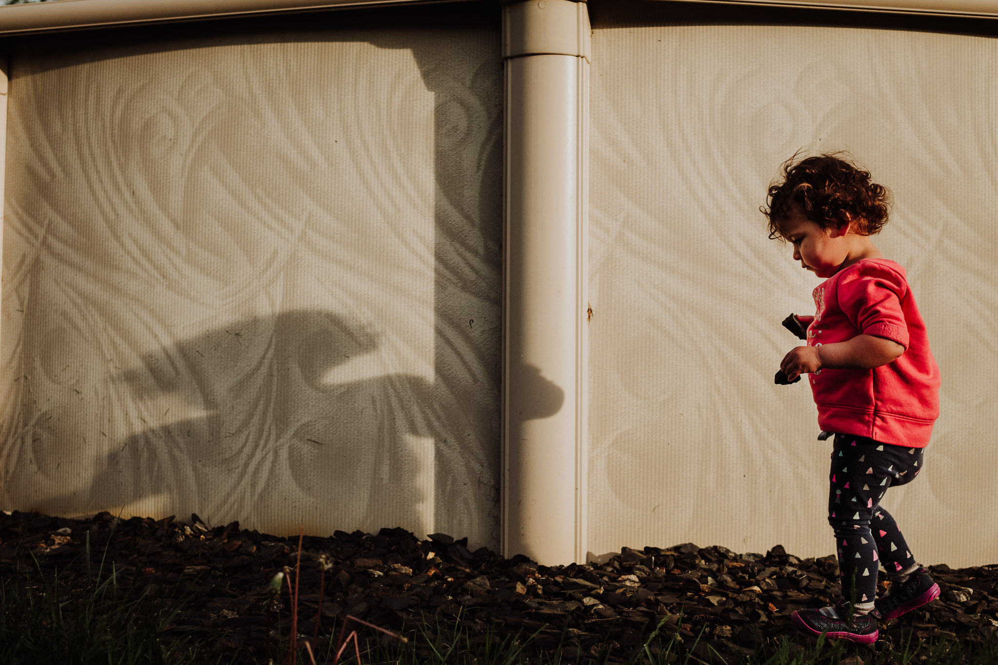 child playing with shadow photography in massachusetts