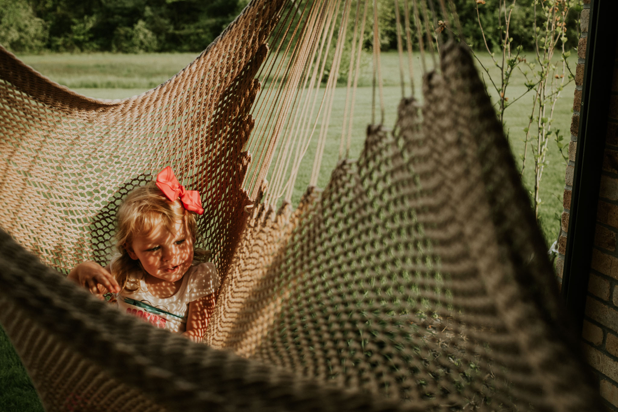 child in hammock summer day in granby massachusetts photography