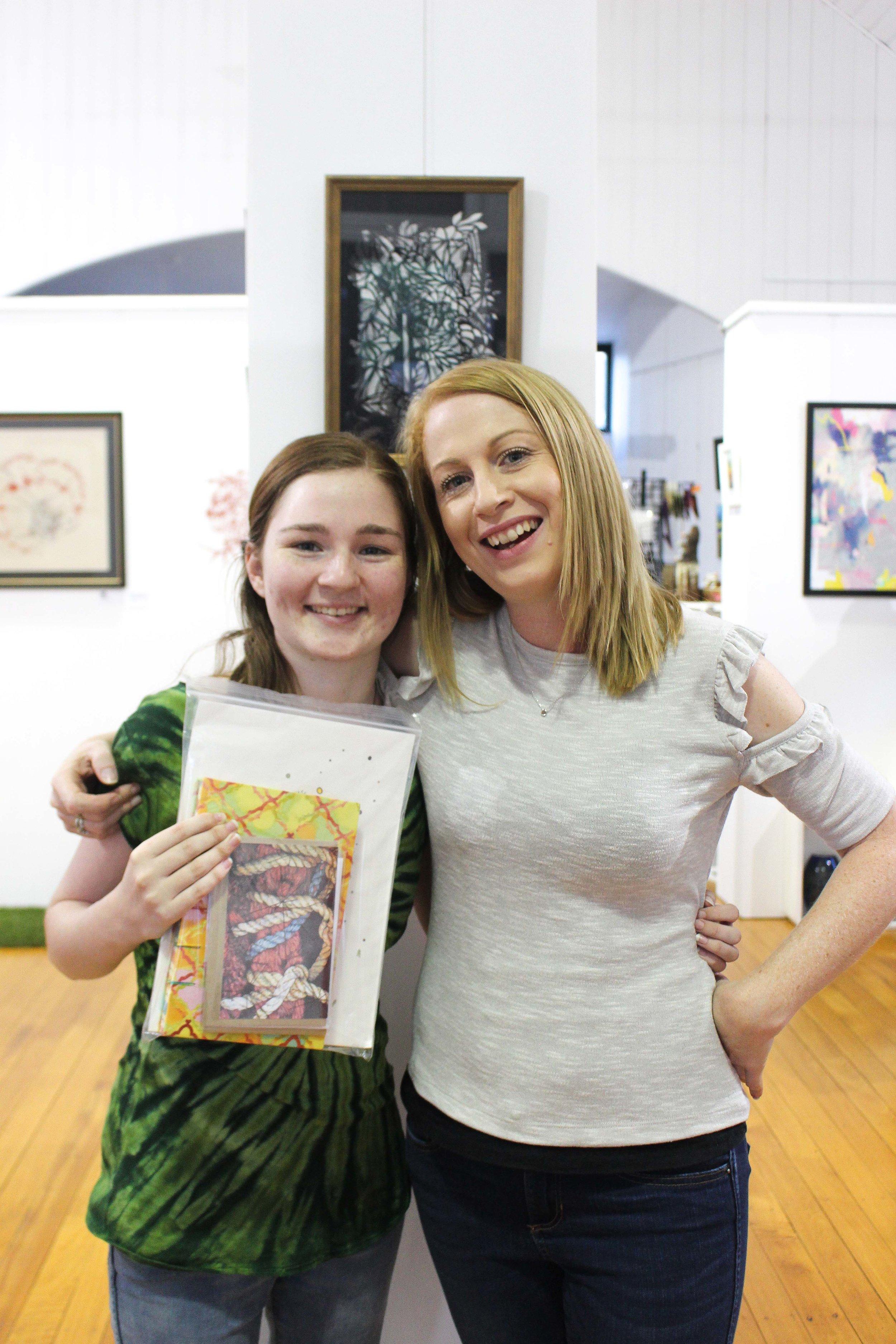 Eden Horner (Lucky Door Prize Winner)and Chantel Schott at Aspire Gallery. Photography by Rochelle Blakelock.