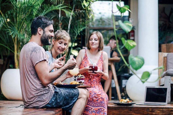 PHOTO:  Brie Moreau with friends in a co-working space in Bali. (Supplied)