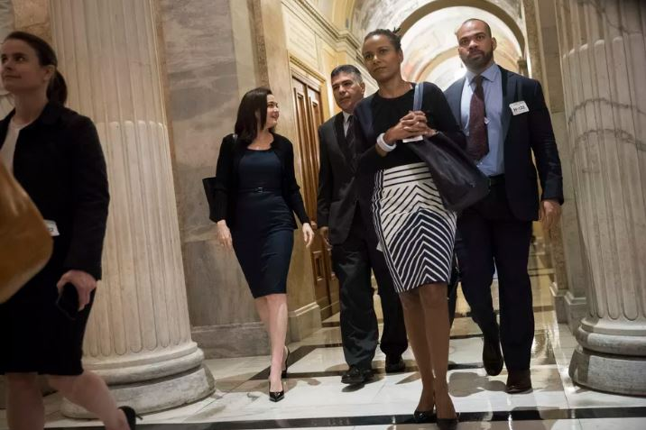 Sheryl Sandberg, chief operating officer of Facebook, walks with Rep. Tony Cardenas (D-CA) on their way to a meeting with members of the Congressional Black Caucus on October 12, 2017 in Washington, DC.  Drew Angerer/Getty Images