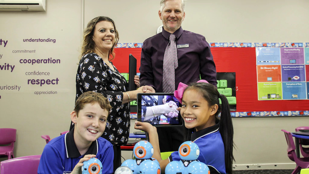 Harvey Primary School parents and citizens committee vice president Narelle Bacich presents school principal Jason Romeo with ipads and Dash and Dot robots, which Year 6 student leaders Mitchell Robinson and Issa Ballares are happy to test run.Picture:Picture: Jacinta Cantatore / Harvey-Waroona Reporter