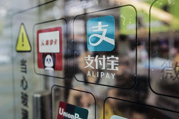 Ant Financial's Alipay payment system has 520 million users. An Austrade delegation of blockchain start-ups visited its Shanghai headquarters on Monday. Qilai Shen