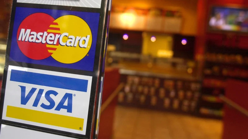 Visa and Mastercard are starting to target the installment payment market. CREDIT:AP