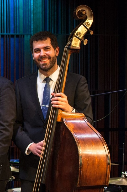 """Joshua Gouzy - upright bass - A multi-generational New Orleans musician, Joshua absorbed the traditions of the city's great bassists: Pops Foster, Wellman Braud, Steve Brown, Al Morgan - and Ed """"Montudie"""" Garland, the linchpin of Kid Ory's rhythm sections of the '40s and '50s. Joshua earned his Bachelor's in Music Education fromLoyola University and his Master's in Music from the University of New Orleans. He is the proprietor of Magnolia Entertainment and a member of eleven New Orleans bands including the Jumbo Shrimp Jazz Band, Aurora Nealand & the Royal Roses, Miss Sophie Lee, The Fritzel's All-Stars, and his own classic R&B band, the Catahoulas. Joshua also performed with and managed the New Orleans Jazz Vipers for over seven years."""