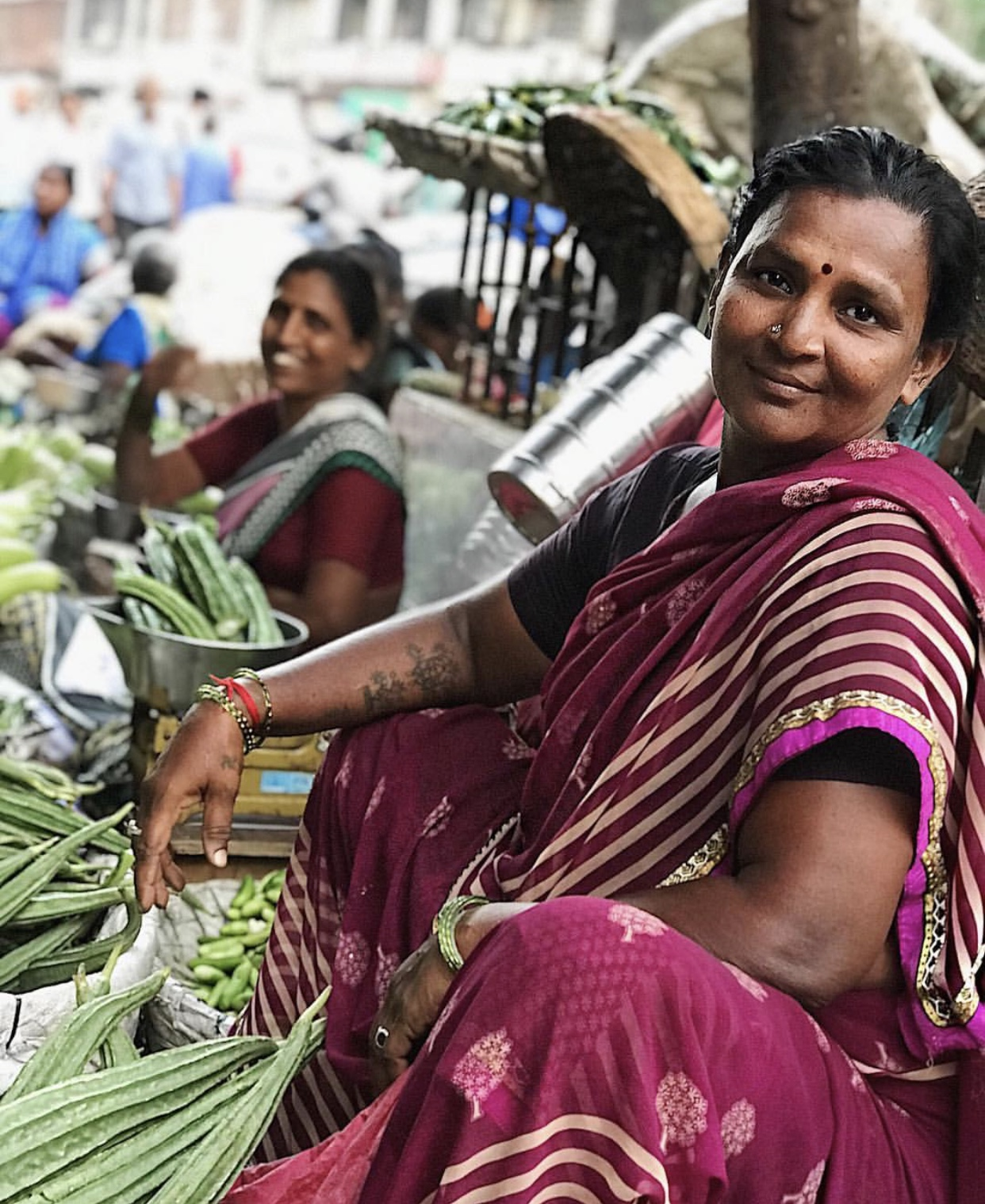 These pretty ladies are selling vegetables at the Crawford market