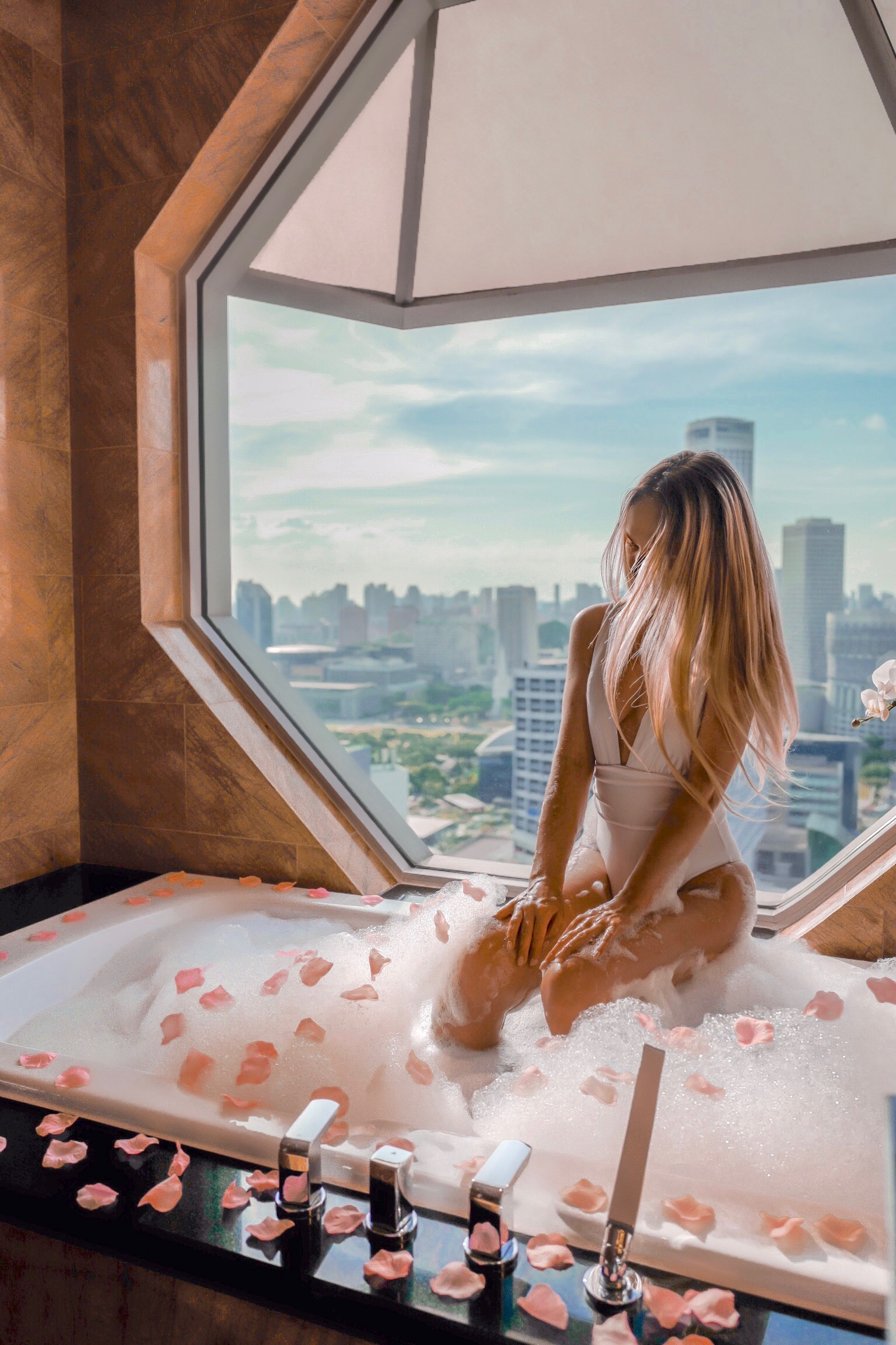 Relaxing Rose petals bath with a beautiful city view