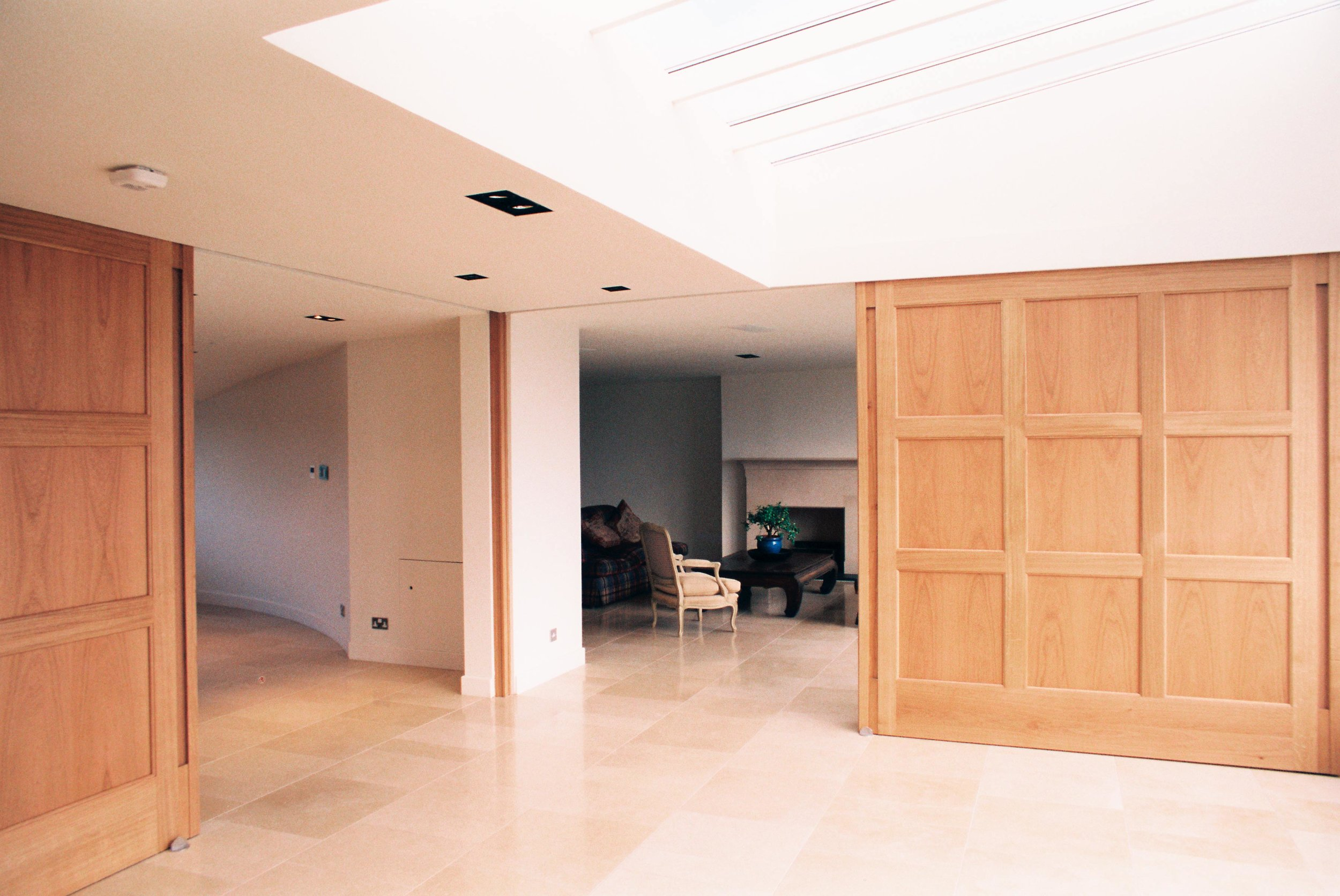 Contemporary sliding room divider in oak, private apartment, Inverleith Edinburgh.