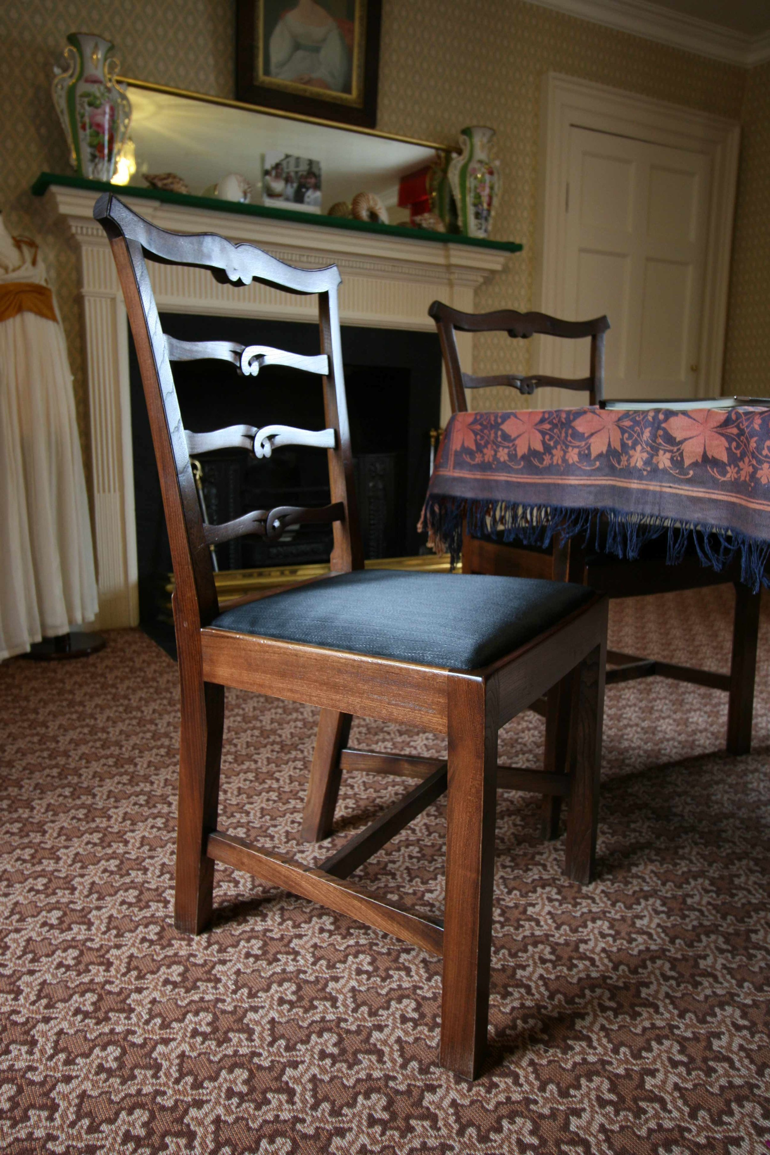 Set of reproduction dining chairs for a historic house.