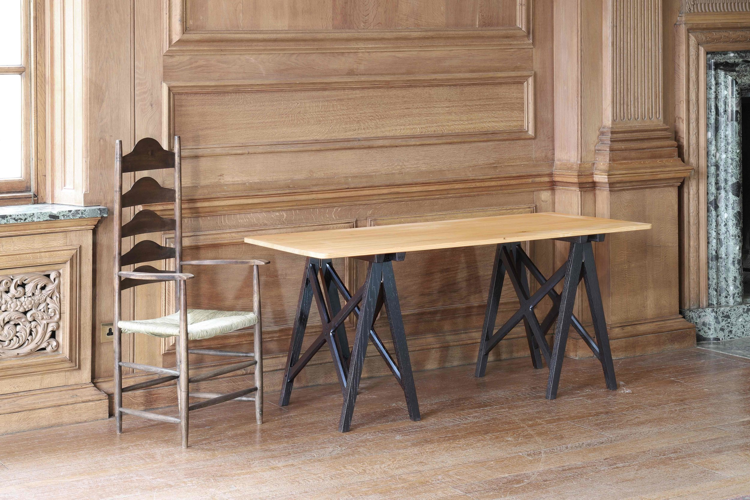 Set of twelve reproduction Ernest Gimson trestle tables. Cedar tops and ebonised oak legs, Marchmont House, Scottish Borders.