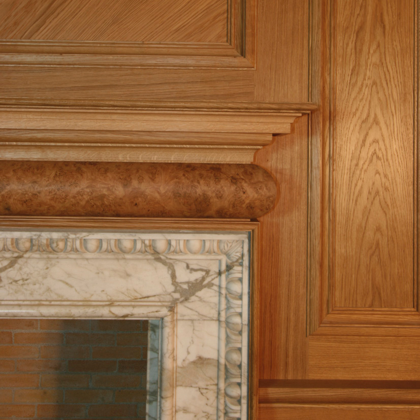 Period oak and burr elm fire surround at Marchmont House, Greenlaw.