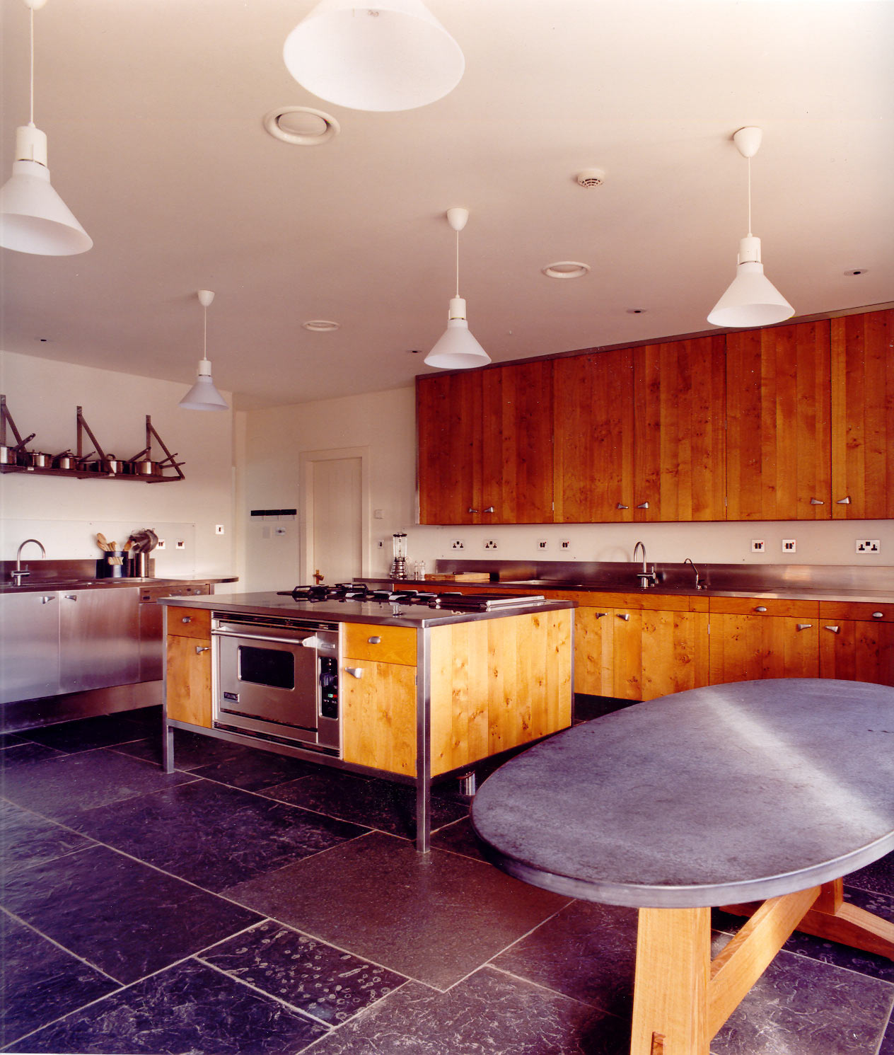 Bespoke kitchen in oak and stainless steel in a castle, Jersey