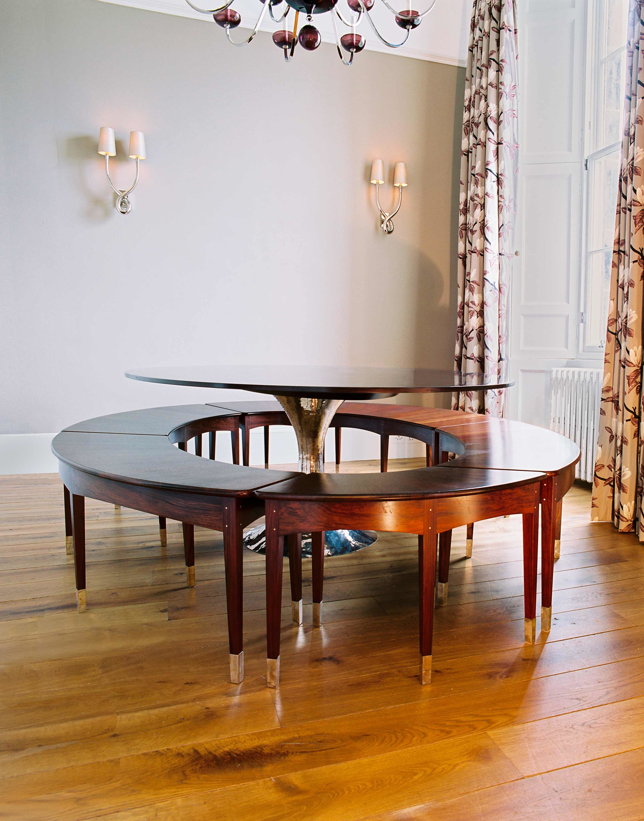 Rosewood elliptical seats and radial rosewood veneered table top, Heriot Row, Edinburgh.