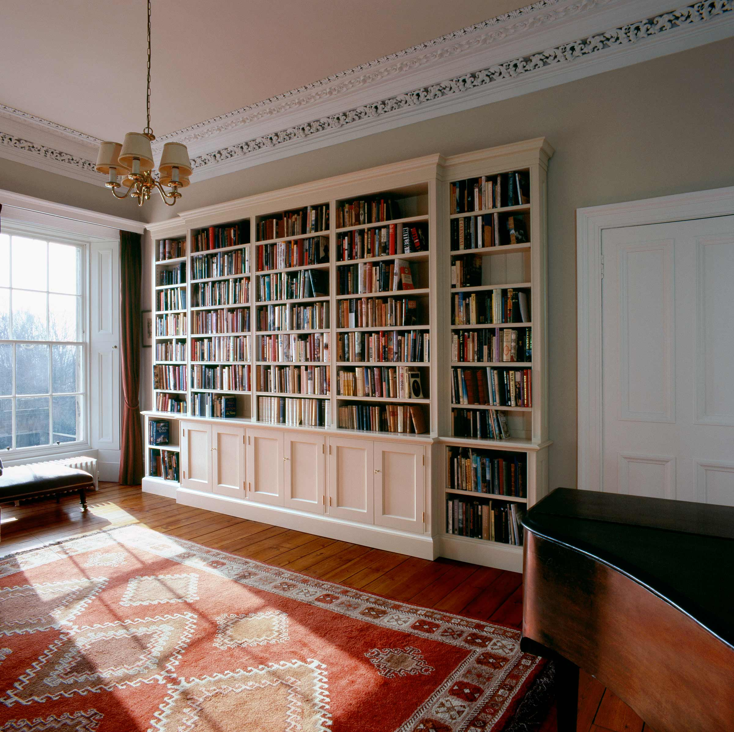 Bespoke white painted bookcase with doors, Edinburgh.