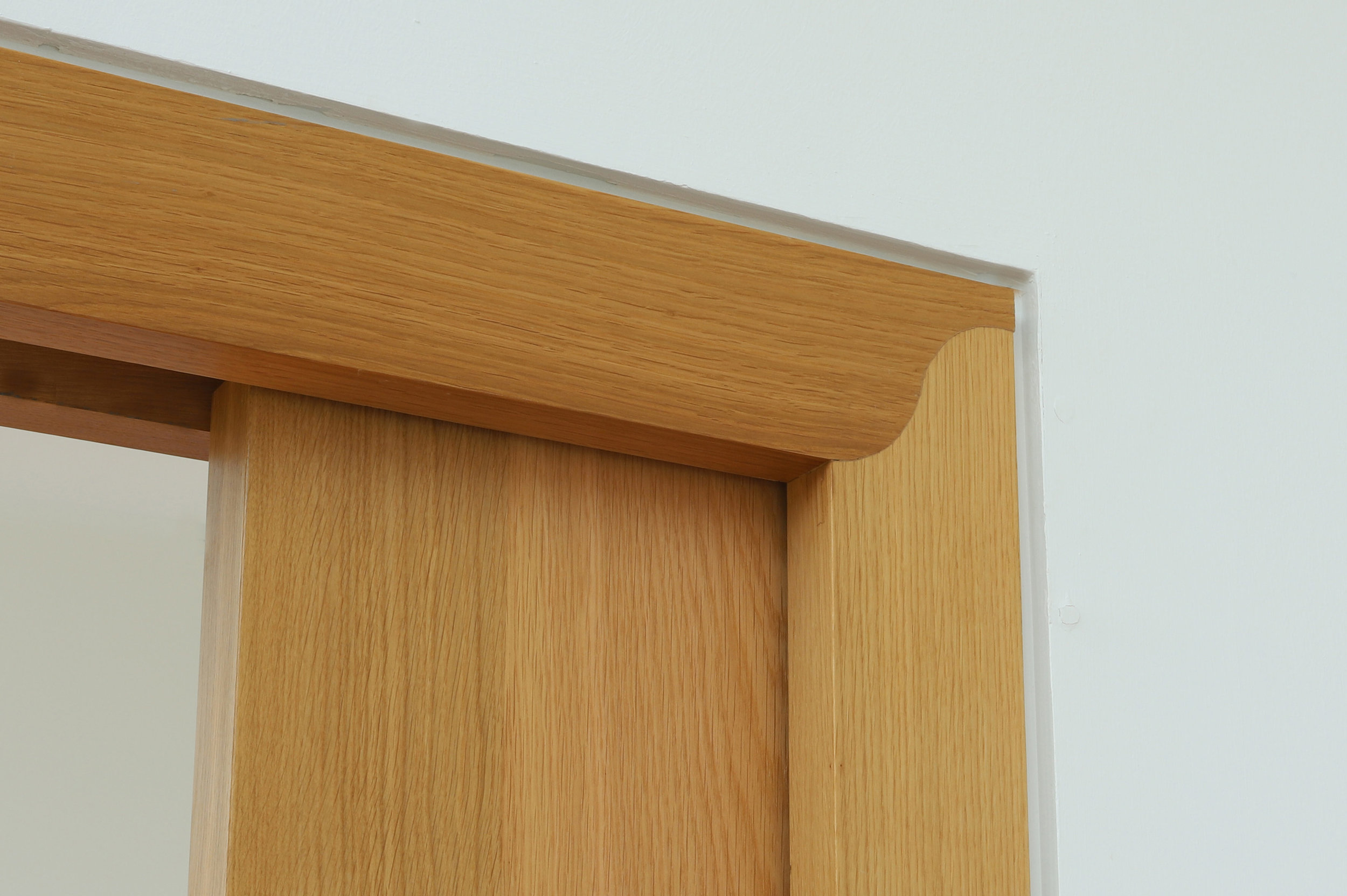 Sliding door made from oak with bespoke mitre detail, Ripple Retreat Loch Venachar.