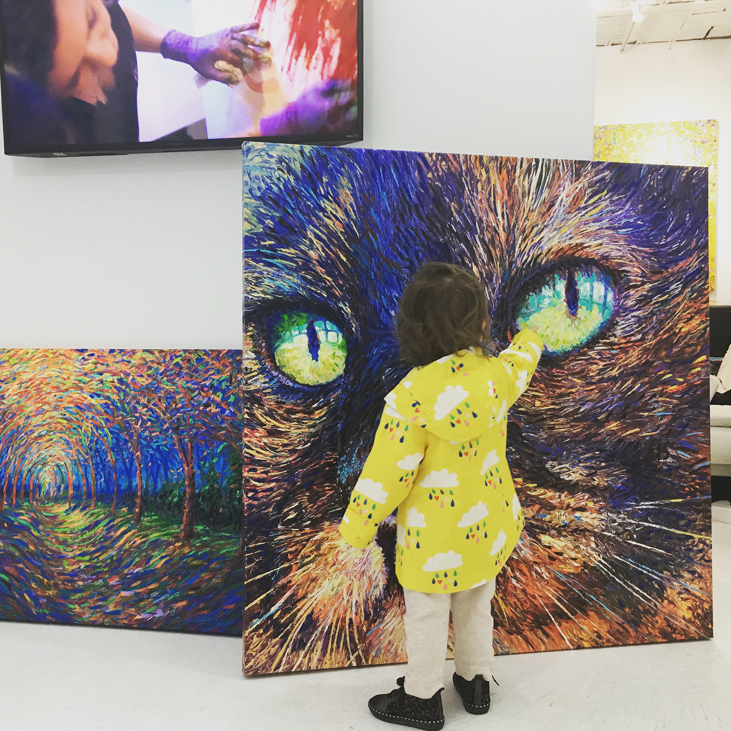 Little girl admiring the finger painted cat of artist Iris Scott at Filo Sofi Arts NYC.png