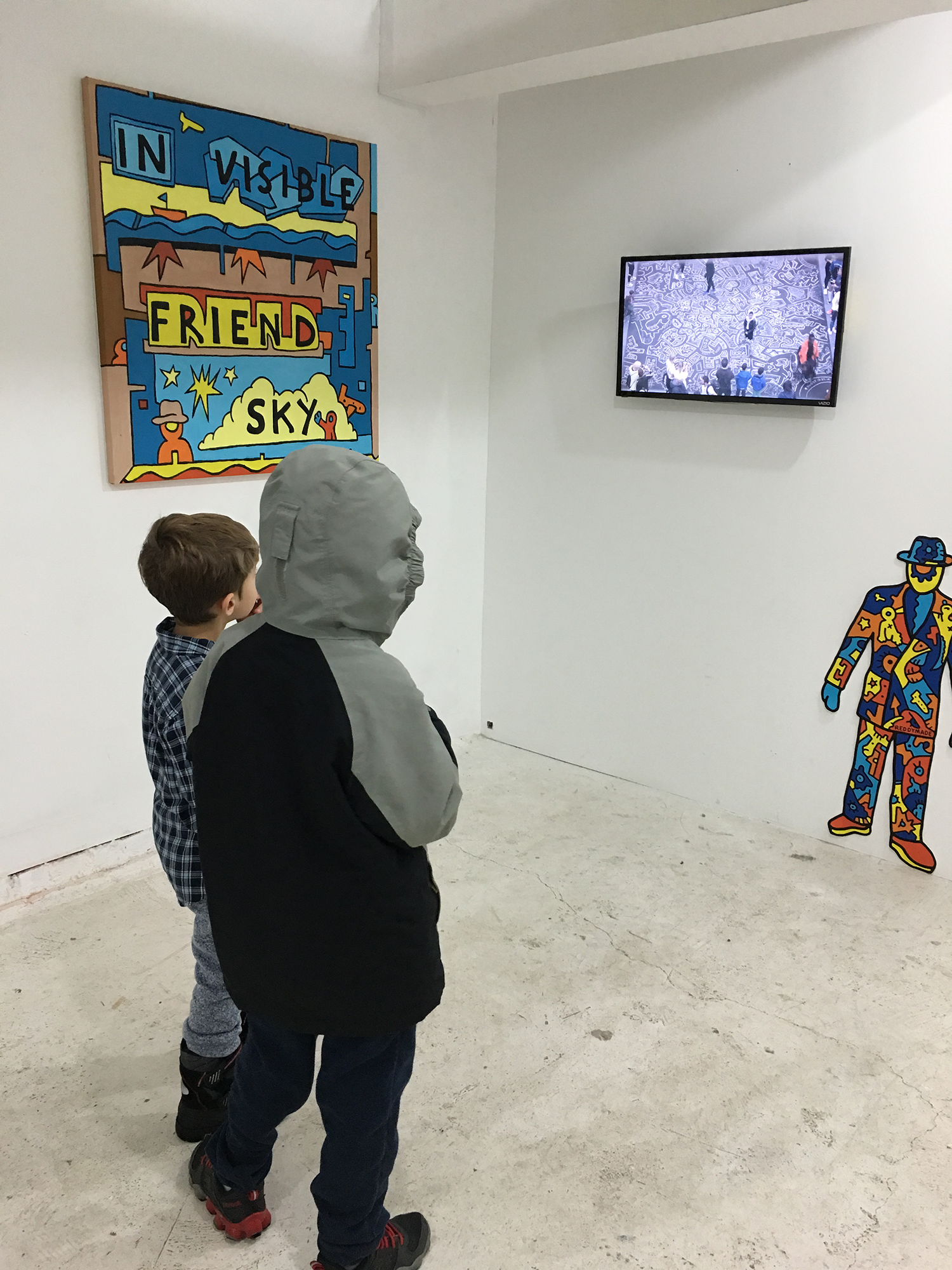 Children watching a performance by psychedelic artist Chris Reddy at Filo Sofi Arts