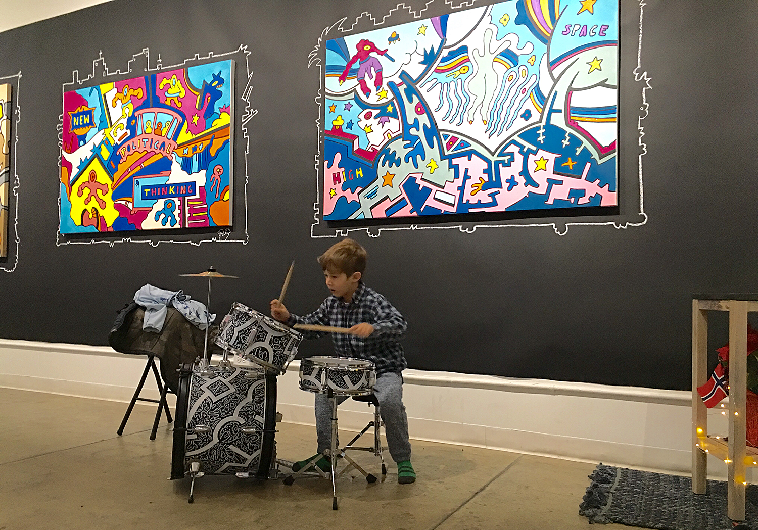 Young boy playing drums during a workshop at Filo Sofi Arts a New York City gallery