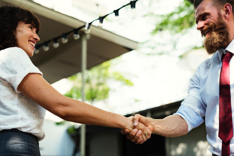 Happy handshake between community members. Supporting relationships between food businesses.