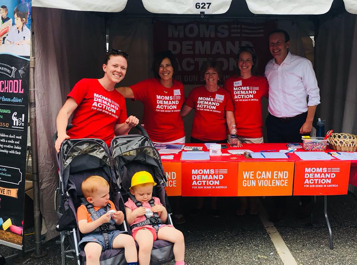 Kate Martin (left), with two of her children, her mom (center), fellow activists and Senator Chris Murphy demonstrate that it takes a village to get things done.