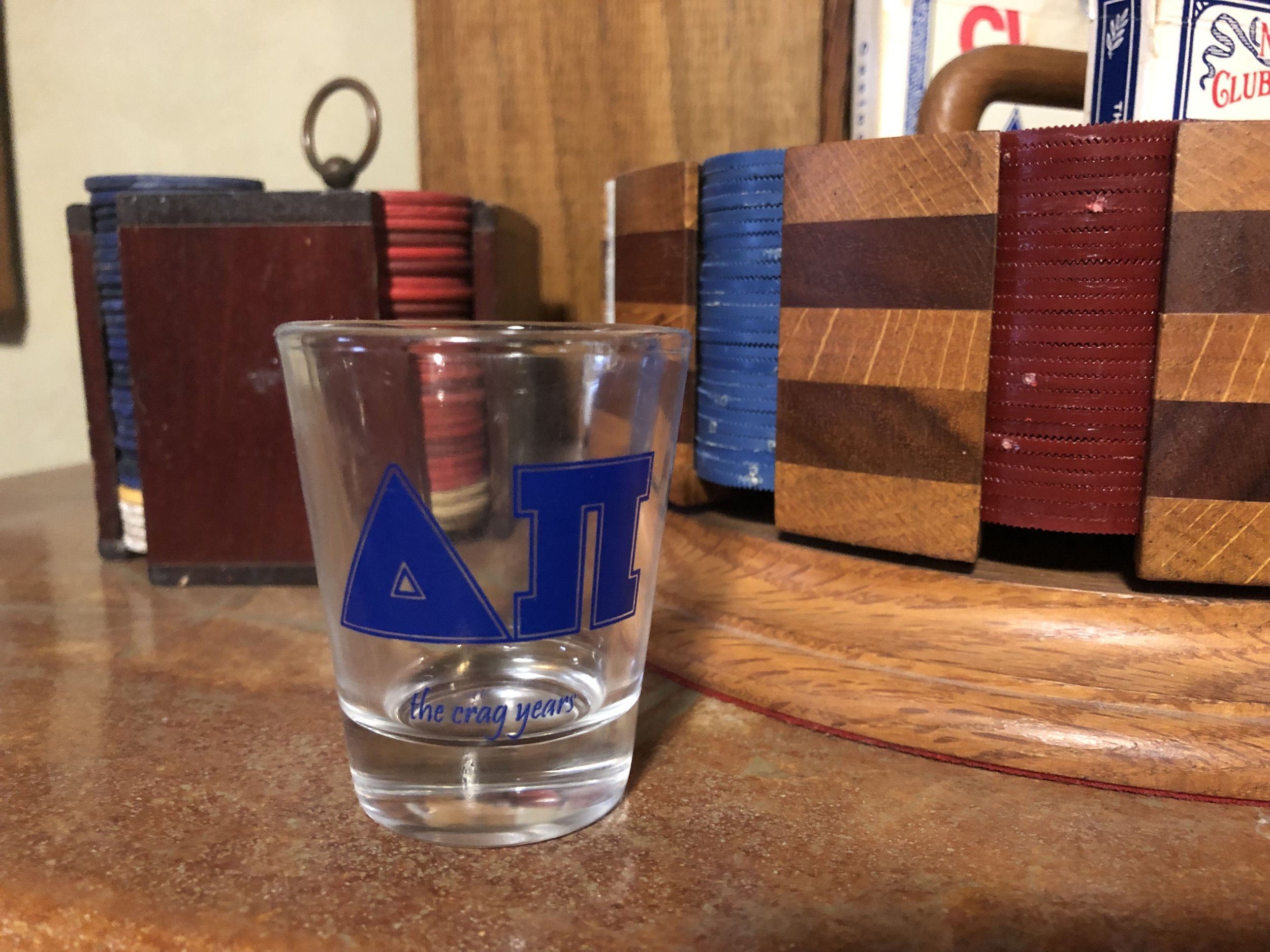 """""""The Crag Years"""" shot glasses."""