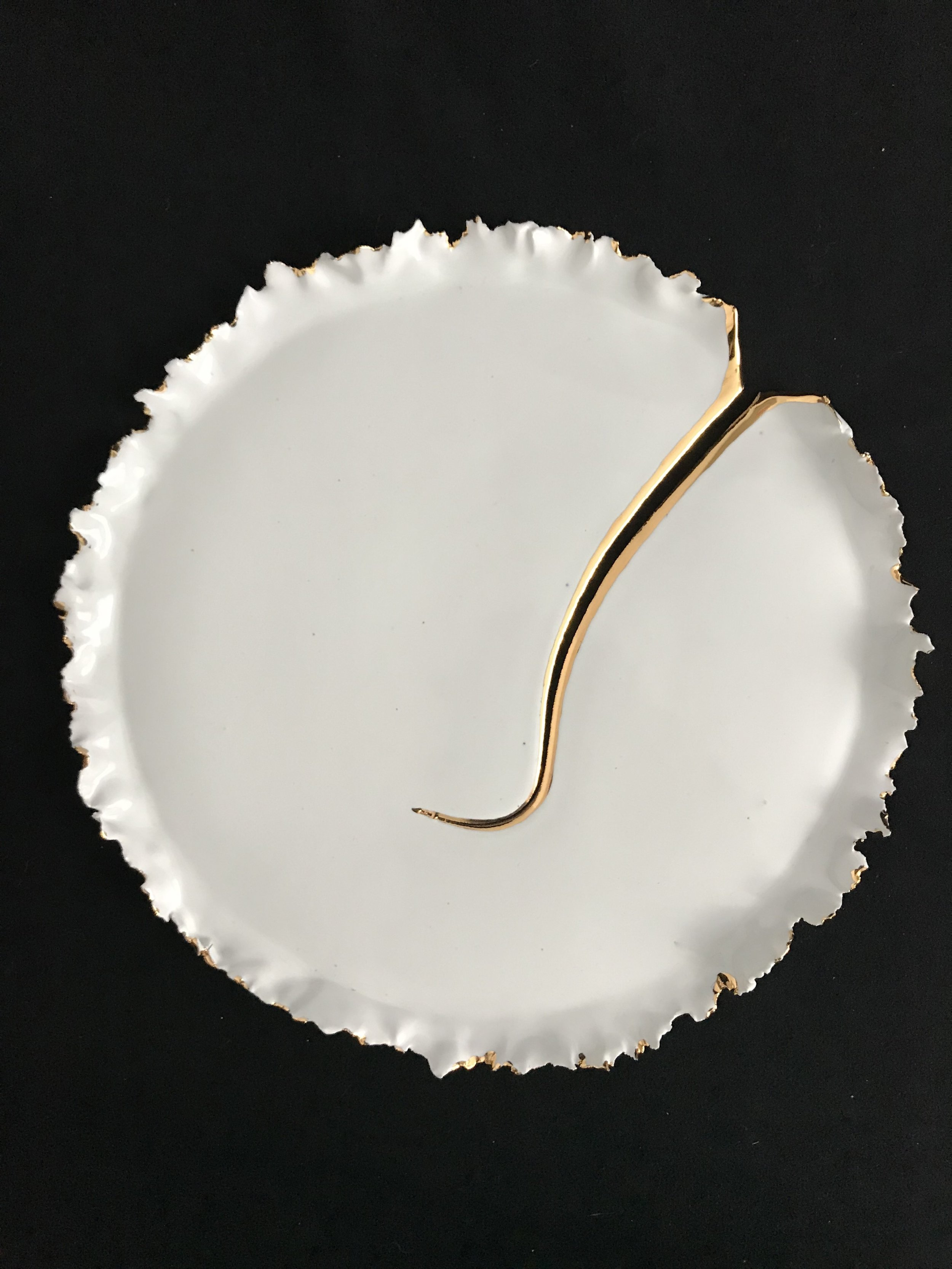 "Victoria Lotus Leaf: How the Light Gets In (Large Crack),  glazed porcelain with gold on cracked area and parts of rim, 1""x12.75""diameter, 2018  SOLD"