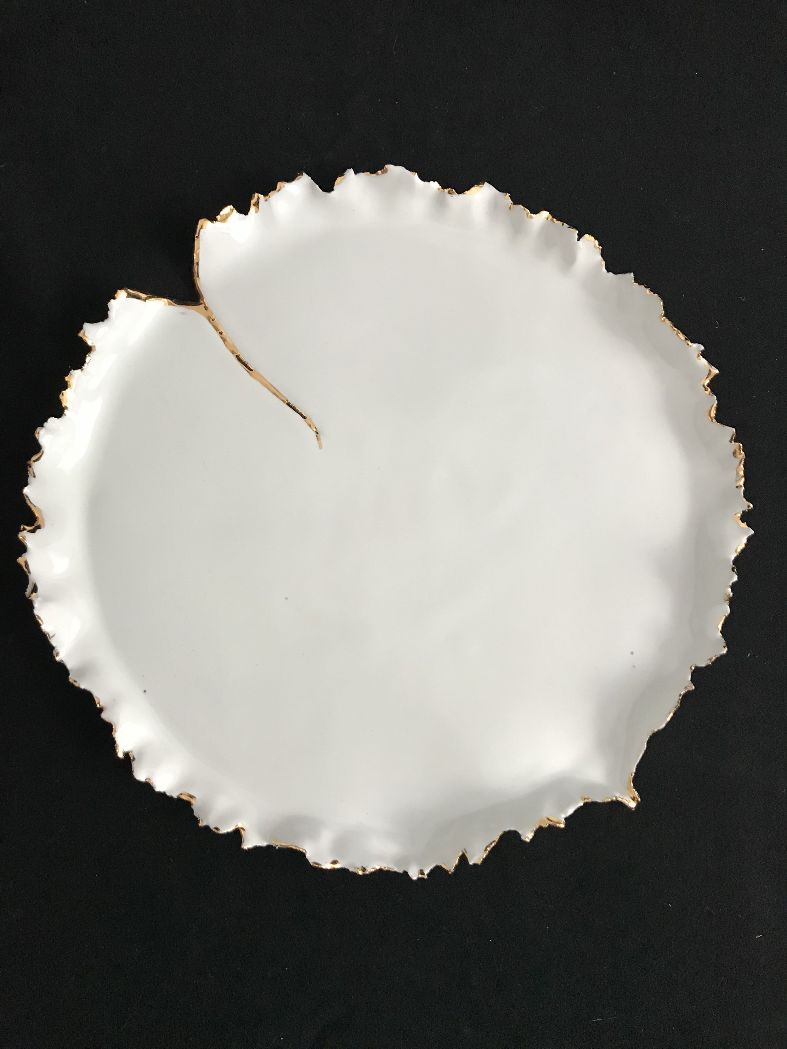 "Victoria Lotus Leaf: How the Light Gets In (Beginning),  glazed porcelain with gold on rim and cracked area, 1""H rim x 10.5""diameter, 2018  SOLD"