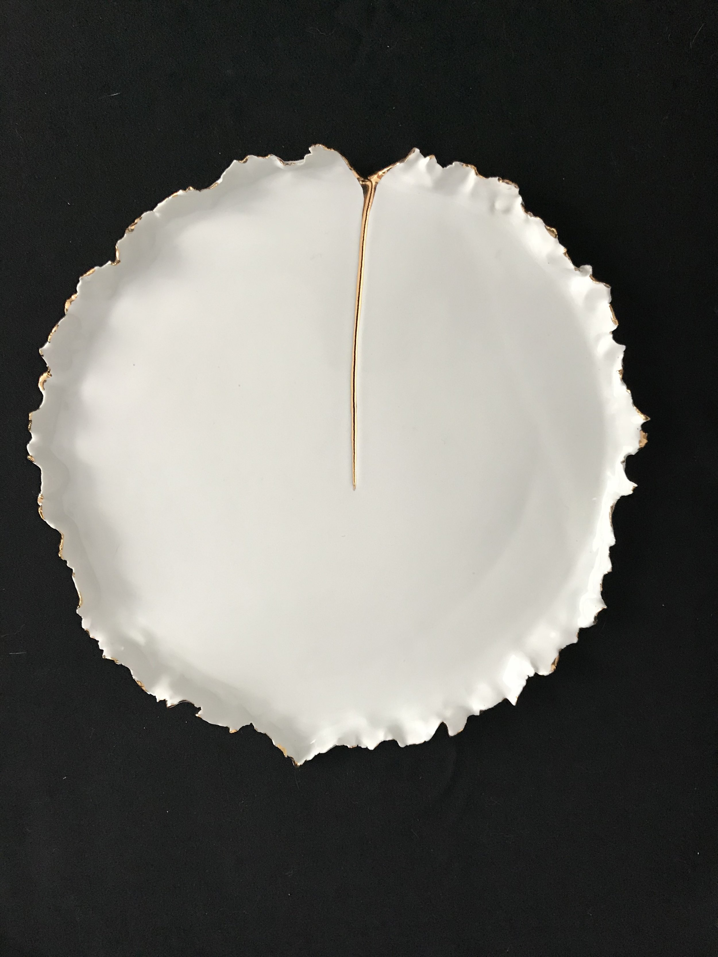 "Victoria Lotus Leaf: How the Light Gets In (Linear),  glazed porcelain with gold cracked area and interspersed on rim, 1""H rim x 10.5"" diameter, 2018  $275"
