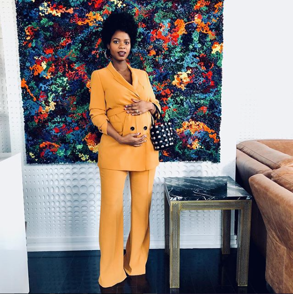 Stylist Carmen Lilly paired a small embellished top handle bag with a two-piece orange suit. ( @stylecarmen )