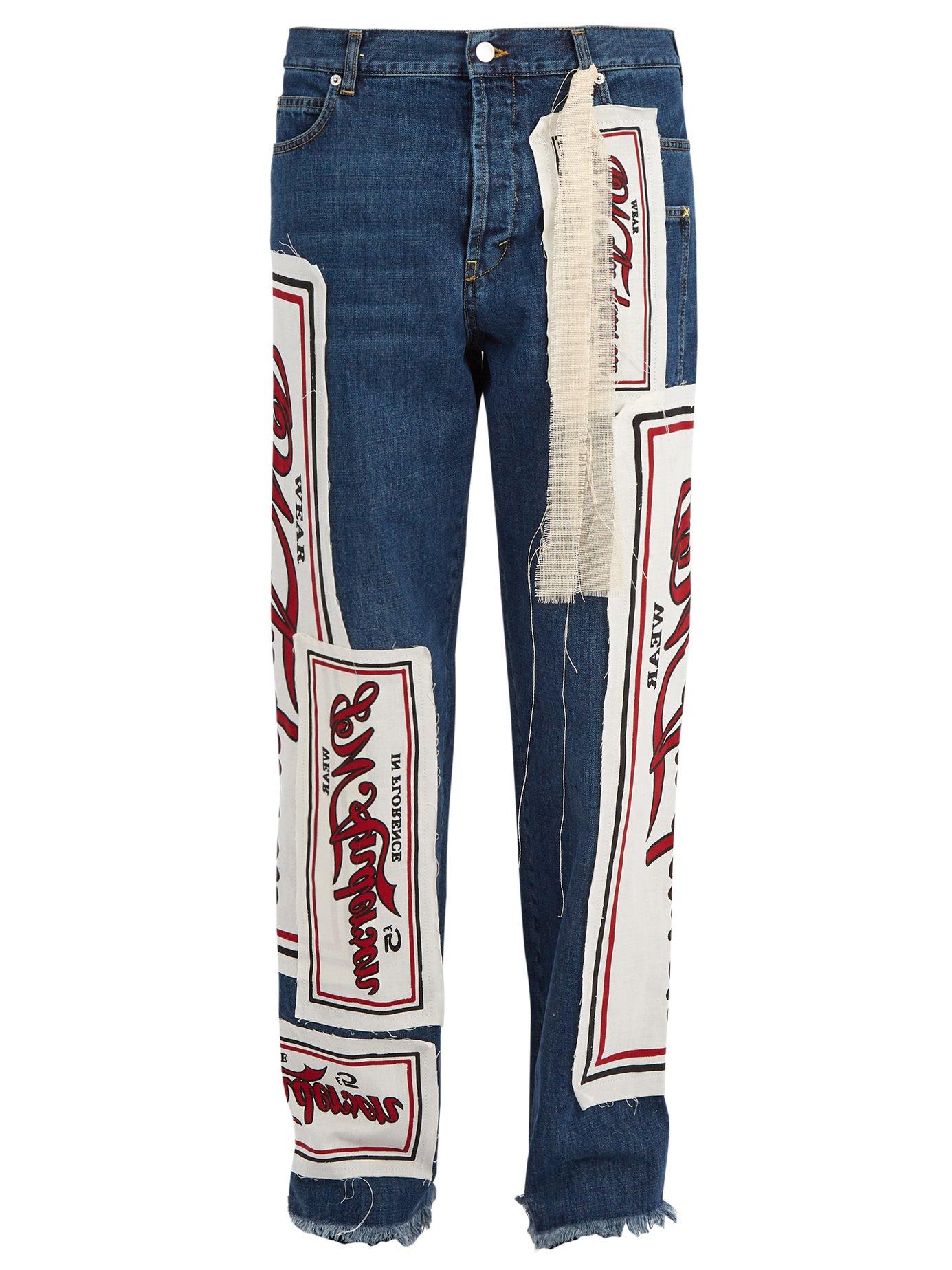JW ANDERSON Printed-appliqué straight-leg jeans $630,  MatchesFashion.com