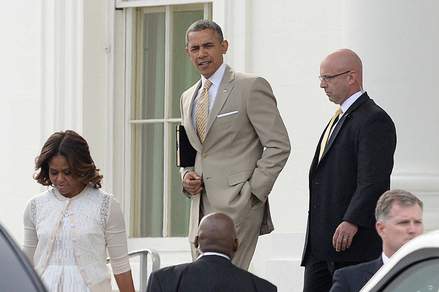 Barack Obama wearing his infamous tan suit. Image Courtesy:  New York Magazine