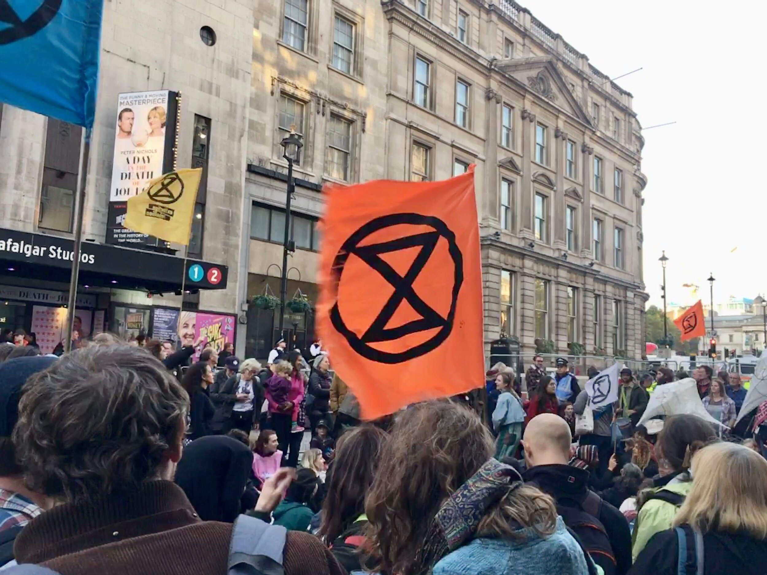 Extinction Rebellion (hourglass symbol) protesters just outside our pub for Happy Hour