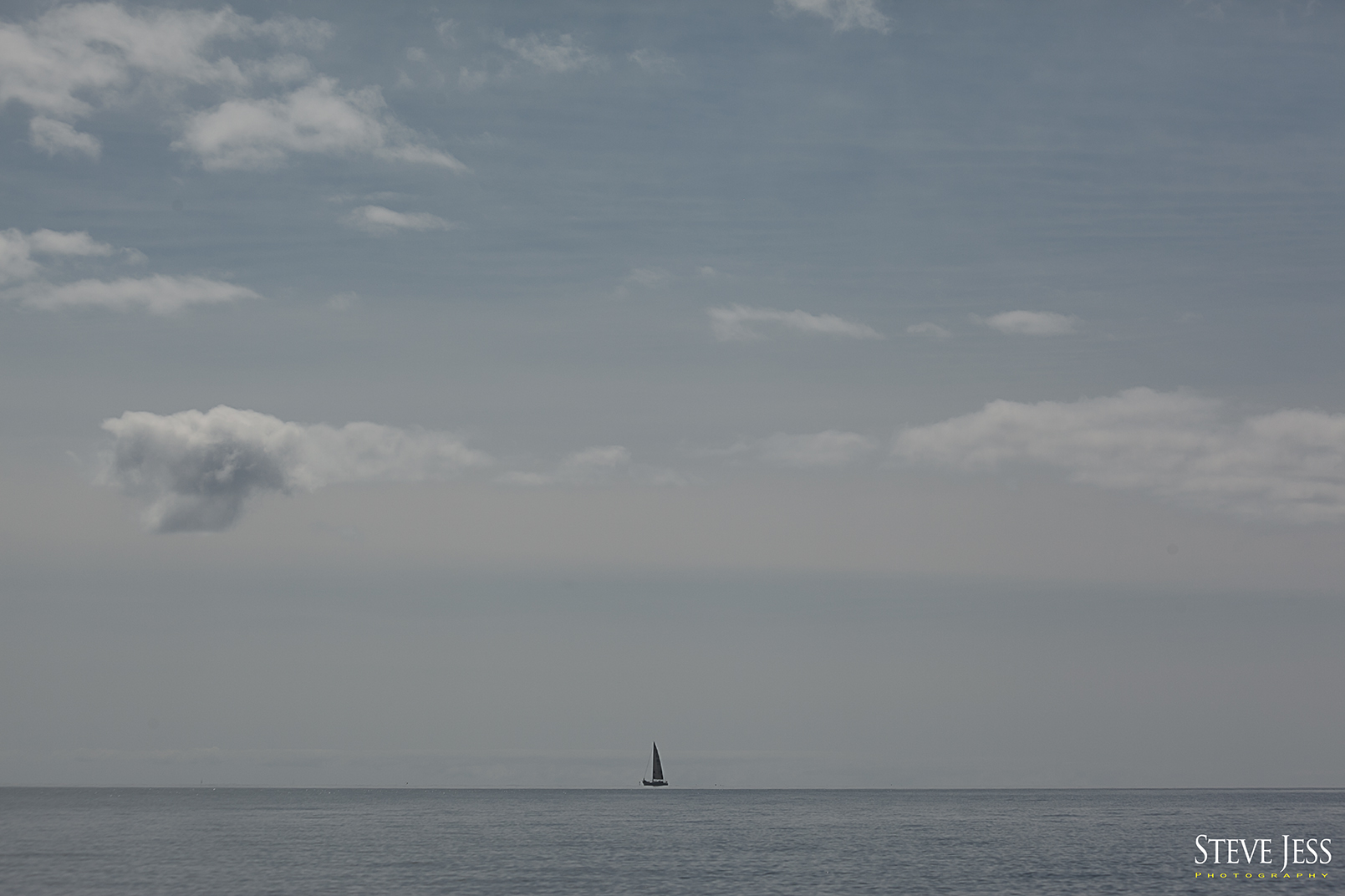 "I don't believe this lone sailboat was part of the race but made a great "" photo-op """