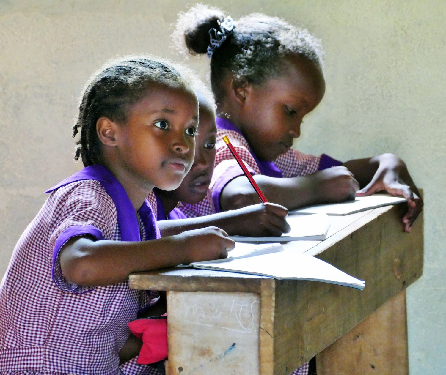 Girls at Tumaini Academy in Northern Kenya are hard at work on their lessons.