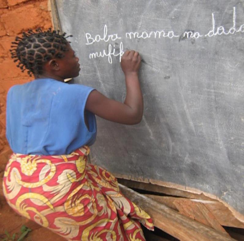 Ms. Clarise Kaputo studies literacy at the school operated by the church in Kalemi-Katanga, DRC.