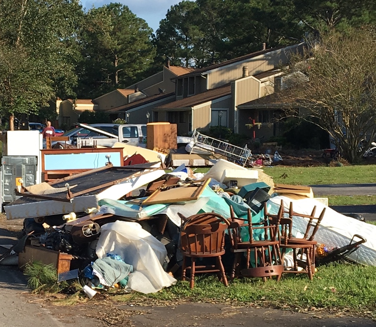 Piles of discarded furnishings line the streets of River Bend, a neighborhood west of downtown New Bern, NC.
