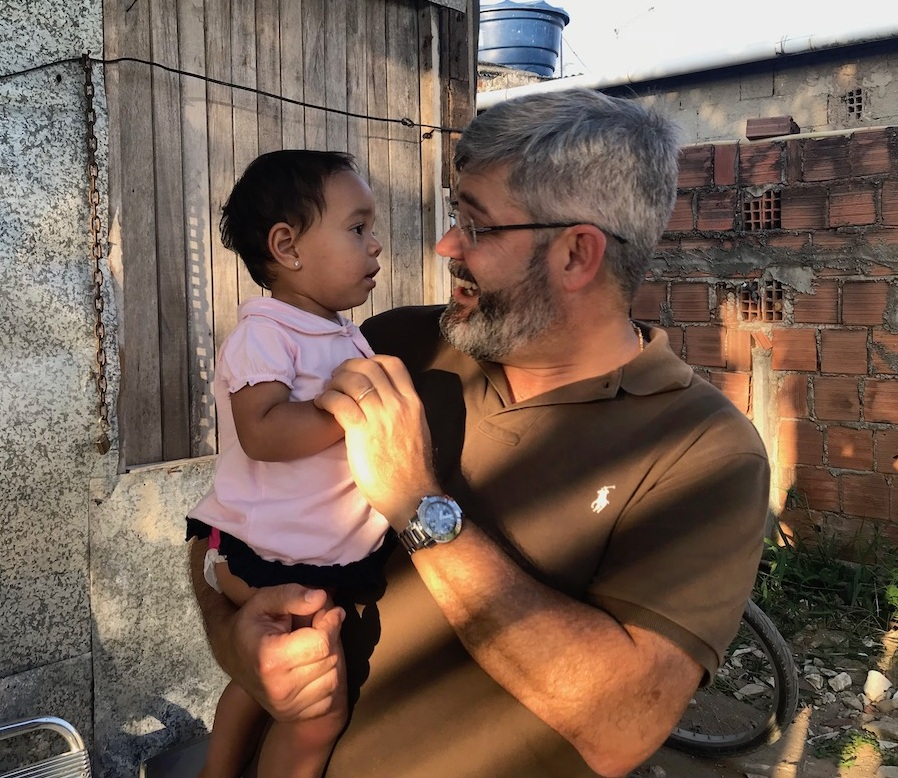 """Pastor Leo Dourado demonstrates God's """"forever love"""" to a child in the slums of Recife, Brazil."""