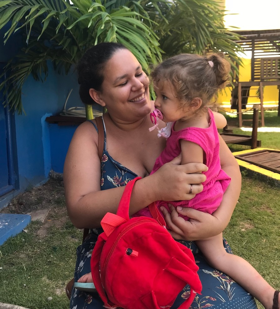 Mirella holding her daughter Marcella in the garden of the House of Hope.