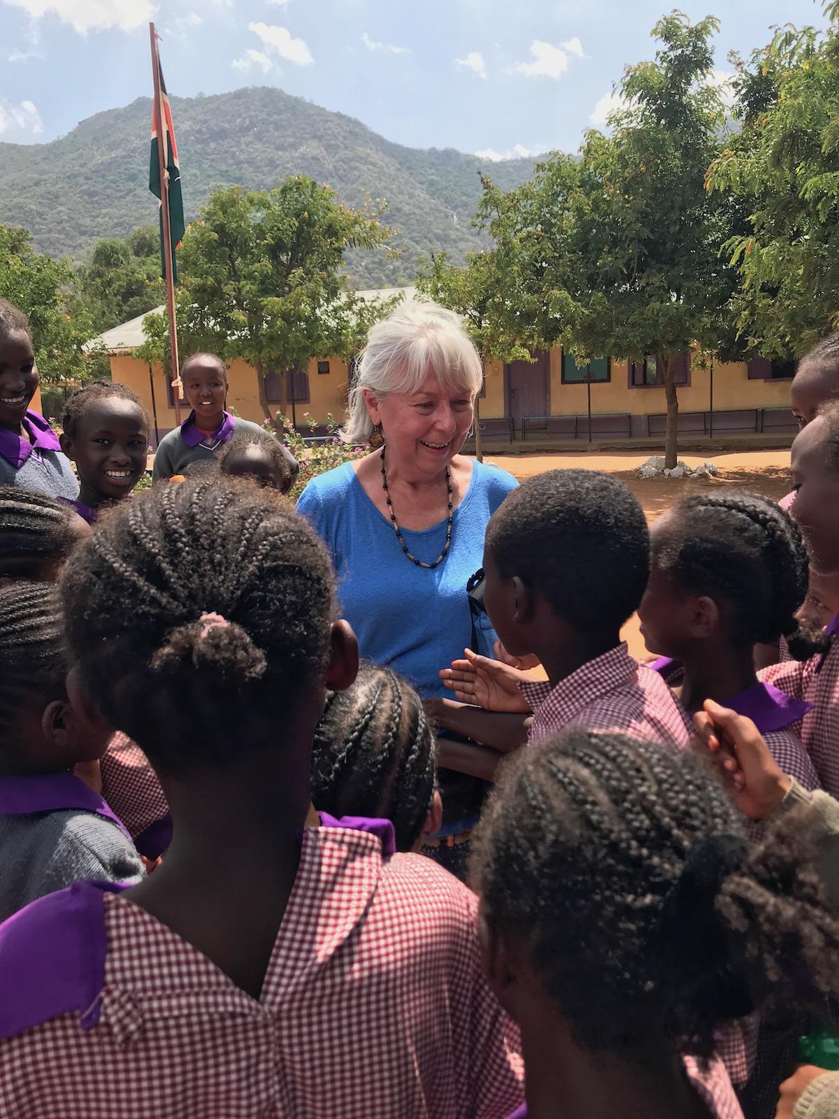 Mary Sisak greet Tumaini students in March 2019.