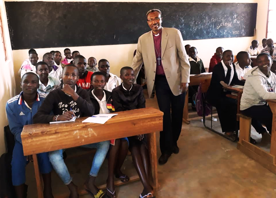Bishop Seth encourages the students in their new classroom in Matana, Burundi.
