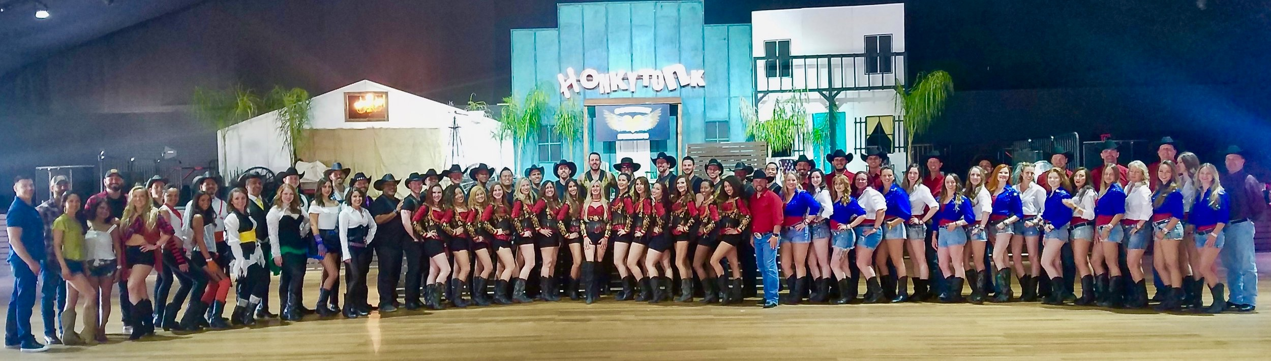 "ALL PERFORMANCE GROUPS FROM THE ""HONKEYTONK' DANCE TENT - STAGECOACH 2019  INCLUDING (FROM LEFT TO RIGHT) WEST COAST SWINGERS, YOUR BELOVED LA WRANGLERS, THE HONKEYTONK LINE DANCE CREW PICTURED IN RED AND BLACK AND ""SOCALI COMFORT"" IN RED, WHITE AND BLUE"