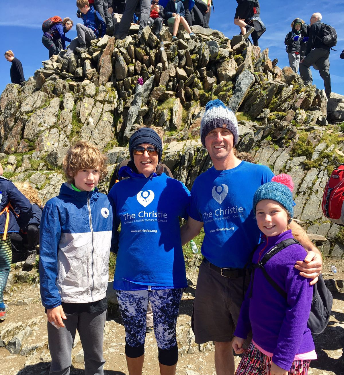 Happy family guided by UProjects to complete their Mount Snowdon challenge