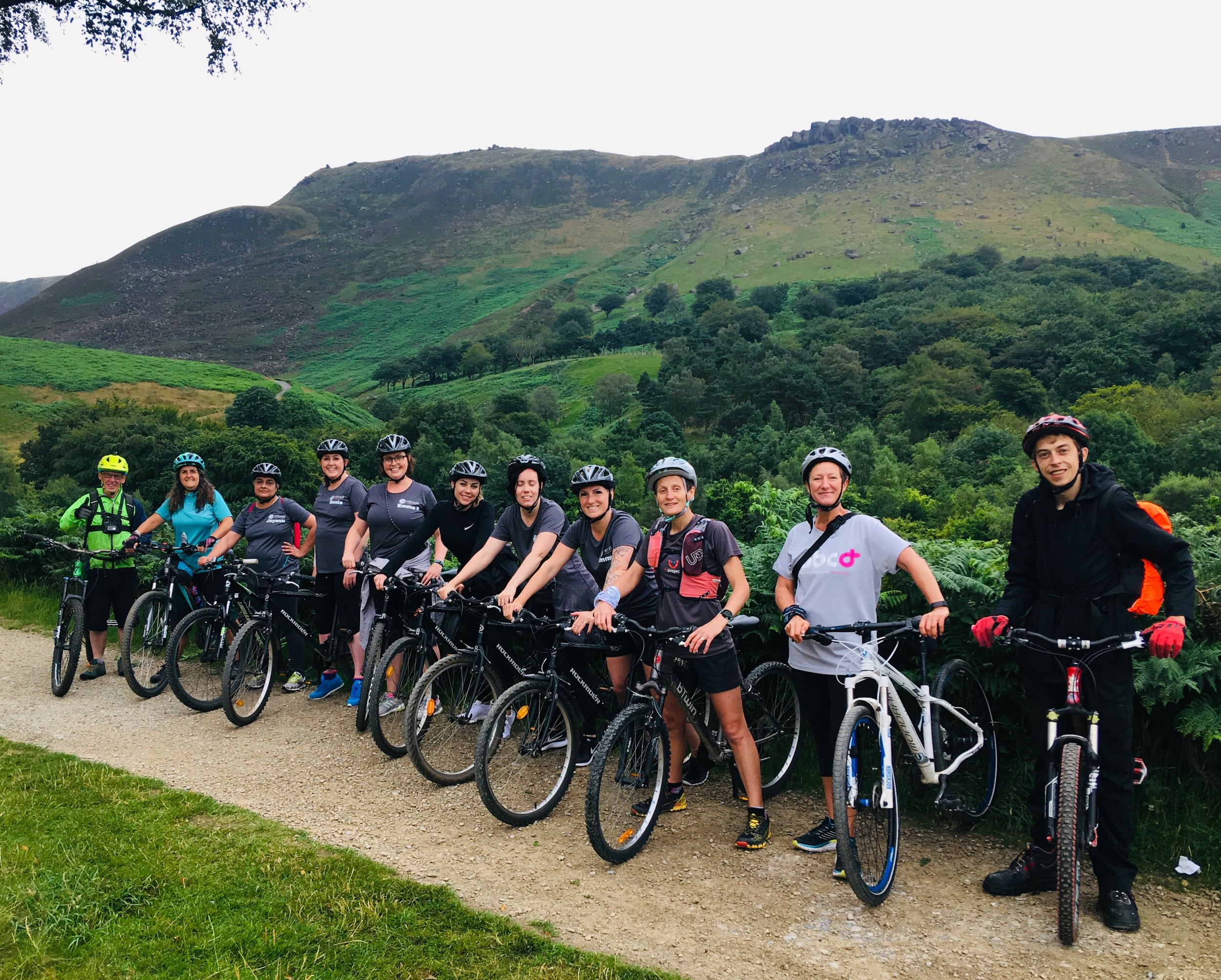 Cycle Group with 'Indians' Head in the background