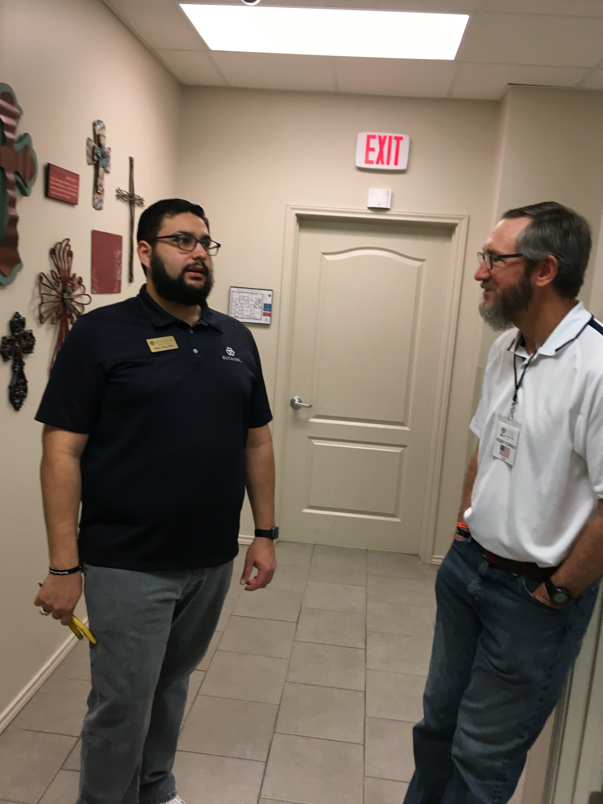 Diego Silva (left), director of Buckner International's Family Hope Center in Peñitas, Texas, visits with Woody Conradt, a lay member of Valley Ranch Baptist Church in Coppell, Texas, before the center's economic strengthening program classes kick off during spring break.