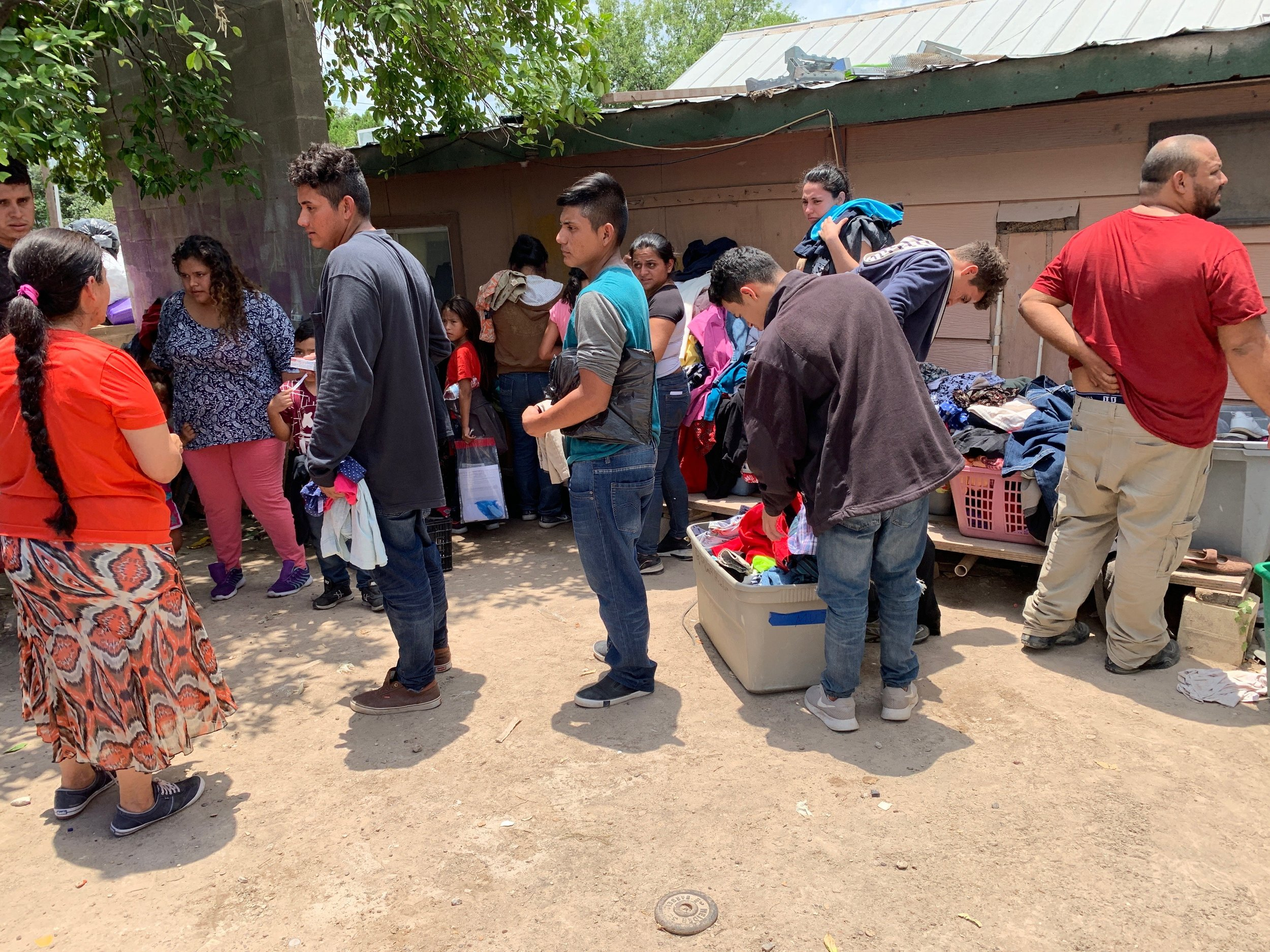 Here are the refugees in the backyard of pastor Ortiz's house looking for clothes before they shower.