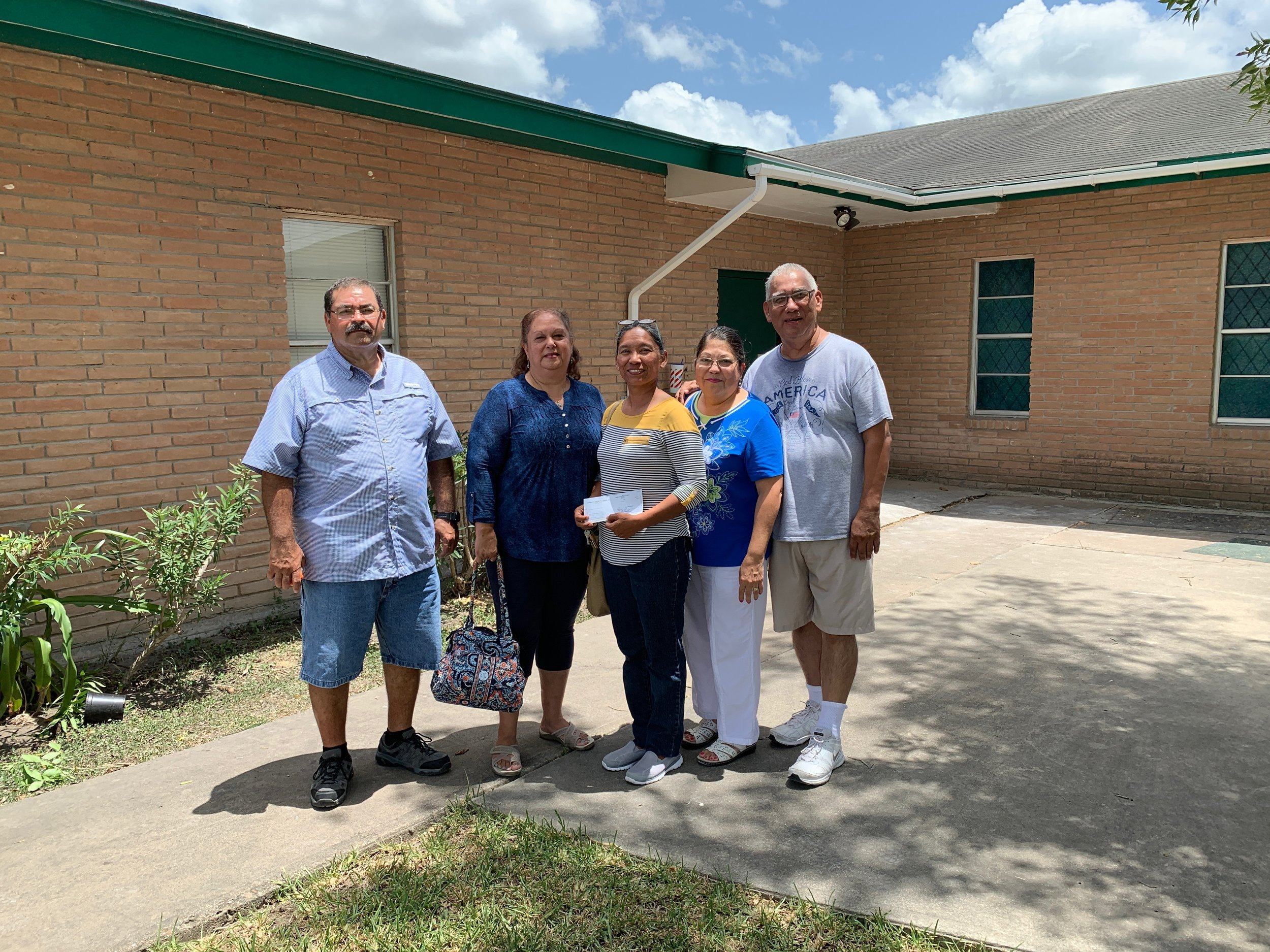 Pastor Roberto Reyes (right) and leaders of Iglesia Bautista Avondale in Harlingen, Texas, expressed thanks for disaster-recovery funds provided by CBF. The money is helping the church acquire supplies to repair its facilities, damaged in a summer flood.