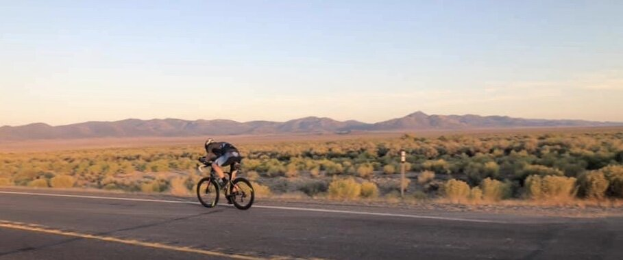 Me, heading towards our Turn-a-Round in Eureka. Rolling through Monitor Valley at Sunset.