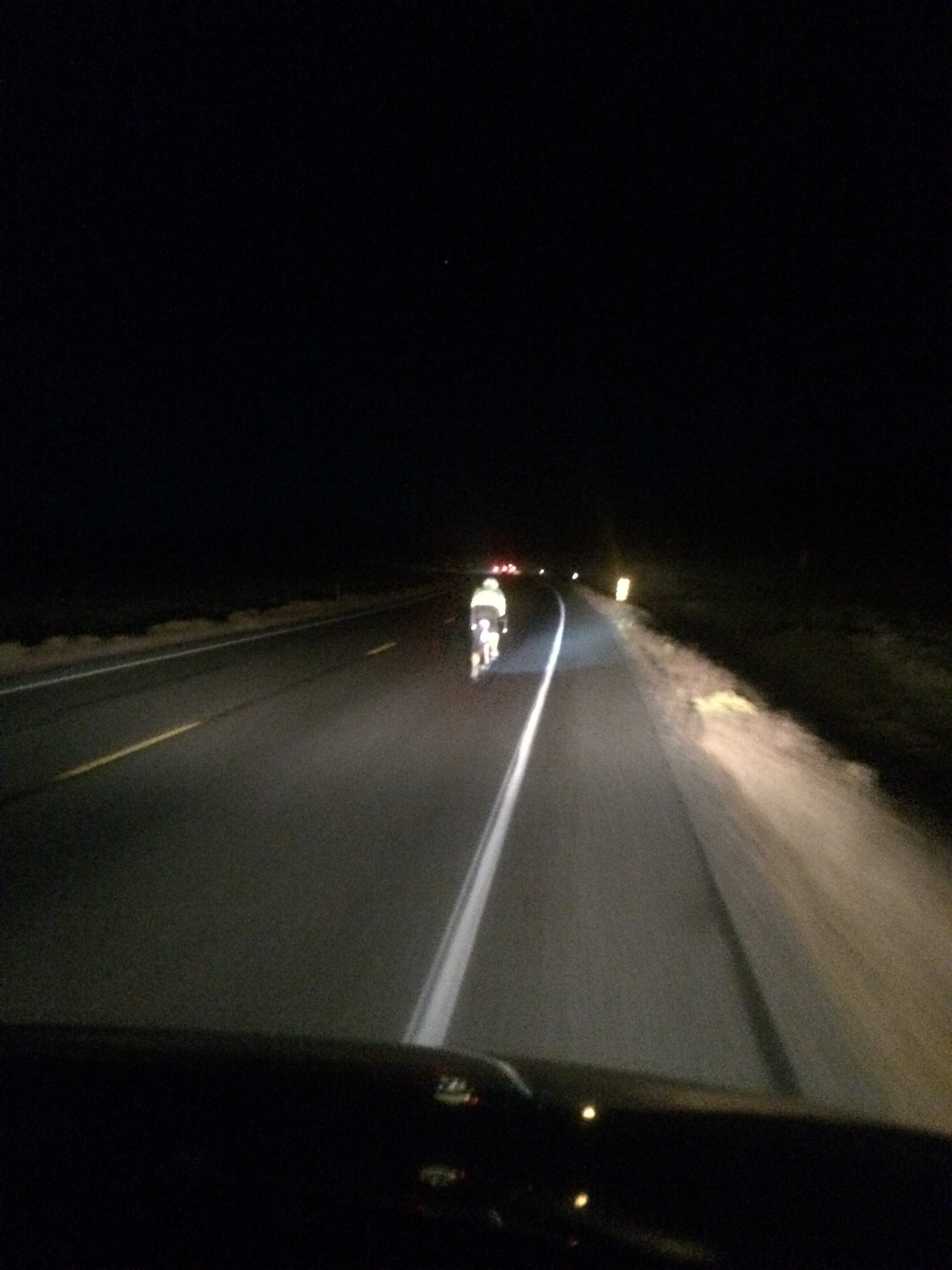 At this point in the race, I have no idea who this is. But, this is what it looks like to Direct Follow your rider at night.
