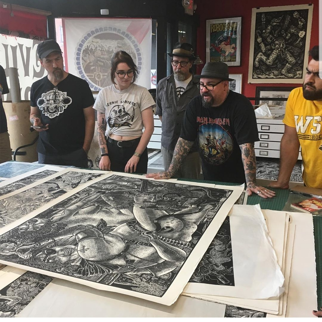 I love this photograph. We four bootcampers are intensely examining a dog penis that took Huck several days to carve in this print that was part of the Bloody Bucket series. (pic by Shannon Cousino)